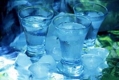 Vodka & ice. Glass with vodka and ice cubs Royalty Free Stock Images