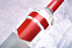 Vodka On Ice. Bottle of Vodka laid on a bed of Ice stock image