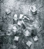 Vodka with ice in glasses. On a rustic background Royalty Free Stock Photos