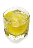Vodka with ice and lemon. In a tetrahedral glass. Object over white Stock Images