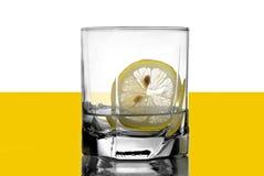 Vodka with a lemon. Digital photo,vodka with a lemon  on yellow Stock Photography
