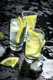 Vodka with lemon and ice. O. N the black chalkboard Royalty Free Stock Photo
