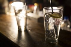 Vodka lemon with ice cubes. On the bar during a rock concert Stock Photography