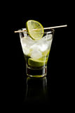 Vodka with lime. And ice on black background Royalty Free Stock Photography