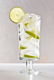 Vodka with lime, ice and soda Stock Photography
