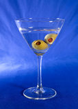 Vodka martini. Two spanish olives a in a cold vodka martini, shaken not stirred Royalty Free Stock Image