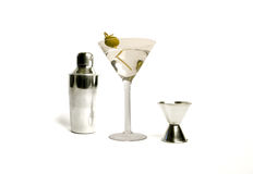 Vodka Martini Cocktail Drink. Freshly made dry vodka martini alcohol cocktail beverage made from a mix of vodka, vermouth,lime slice and green olive Royalty Free Stock Photos