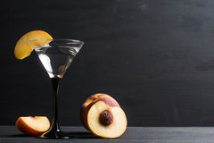 Vodka and martini cocktail. Vodka and martini with fresh peaches Stock Photo