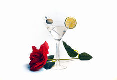 Vodka Martini Valentine`s Day Cocktail Drink. Freshly made dry vodka martini alcohol cocktail beverage made from a mix of vodka, vermouth,lime slice and green Royalty Free Stock Photo