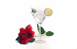 Vodka Martini Valentine`s Day Cocktail Drink. Freshly made dry vodka martini alcohol cocktail beverage made from a mix of vodka, vermouth,lime slice and green Royalty Free Stock Images