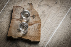 Vodka. On old wooden table Royalty Free Stock Photo