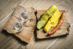 Vodka and pickled cucumber Royalty Free Stock Photography