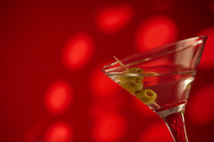 Vodka and red. Vodka and olives on a red background Royalty Free Stock Photos