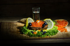 Vodka with red caviar Stock Images