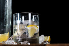 Vodka on the rocks. (on an old wooden table) as detailed close-up shot Royalty Free Stock Photo