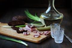 Vodka salada del ruso del aperitivo del tocino imágenes de archivo libres de regalías