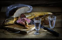 Vodka and salmon. Vodka in two galsses and salted salmon and black bread still life Stock Photo
