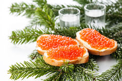 Vodka and sandwiches with red caviar Stock Photos
