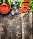 Vodka and sandwiches with red caviar. royalty free stock images