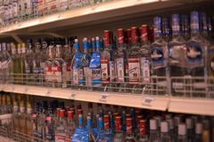 Vodka on the shelves in a supermarket Stock Photos