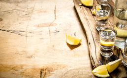 Vodka in shot glasses with lemon. Royalty Free Stock Photography