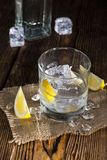 Vodka. Shot of ice cold Vodka on rustic wooden background Royalty Free Stock Images