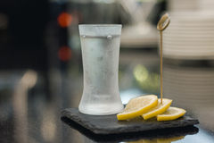 Vodka shot with lemon slices Royalty Free Stock Photo