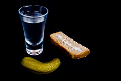 Vodka shot with snacks. Vodka shot wuth snacks isolated on black Stock Images