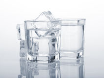 Vodka shots with ice cubes Stock Photo