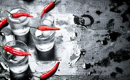 Free Vodka Shots With Hot Chili Peppers And Ice. Stock Photo - 108694280
