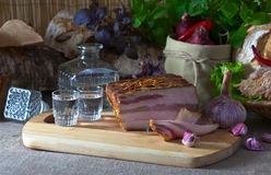 Vodka and smoked meat with garlic Stock Image