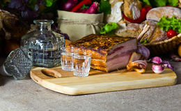 Vodka and smoked meat Stock Photo