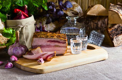 Vodka and smoked meat Stock Photos