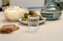 Vodka and snack. Royalty Free Stock Photos