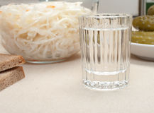 Vodka and snack. Stock Image
