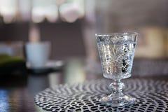 Vodka som skjutas i exponeringsglaset arkivfoton