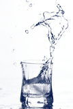 Vodka splash Stock Photography