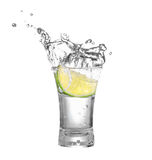 Vodka or tequila in glass with lime slice Royalty Free Stock Photos