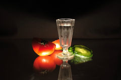 Vodka and vegetables Stock Photo