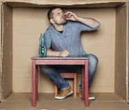 Vodka way to escape from the problems. Man in the box Stock Photography