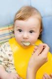Voedende baby Stock Foto's