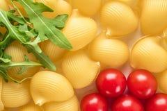 Voedsel Ongekookte Macaroni als achtergrond Lumaconi stock fotografie