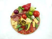 Voedsel op een ronde scherpe raad Stock Fotografie