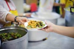 Voedsel voor de Armen: concept die Honger en Voedsel aanpakken royalty-vrije stock foto