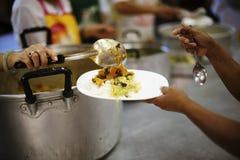 Voedsel voor de Armen: concept die Honger en Voedsel aanpakken stock fotografie