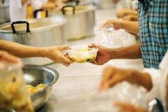 Voedsel voor de Armen: concept die Honger en Voedsel aanpakken stock afbeelding
