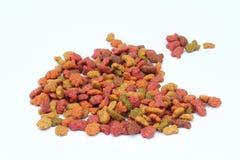 Voedsel voor katten of honden op witte achtergrond worden geïsoleerd die Stock Foto