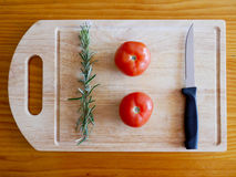Voedselbeeld: Tomaat en Rosemary Royalty-vrije Stock Foto's
