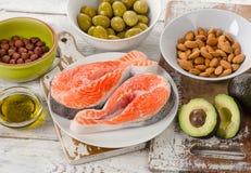 Voedselbronnen van onverzadigde vetten Het eten van het dieet stock afbeelding