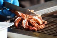 Voedselvoorbereiding, geroosterde octopus royalty-vrije stock afbeeldingen